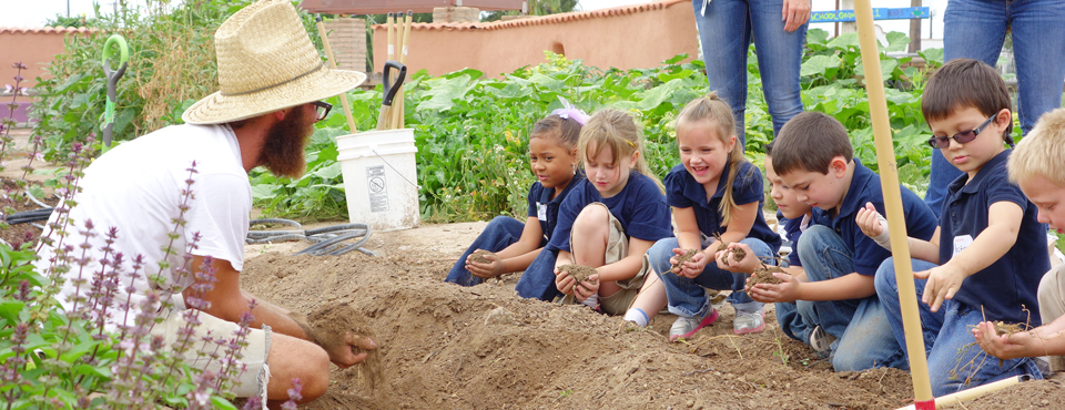 Children learning about soil